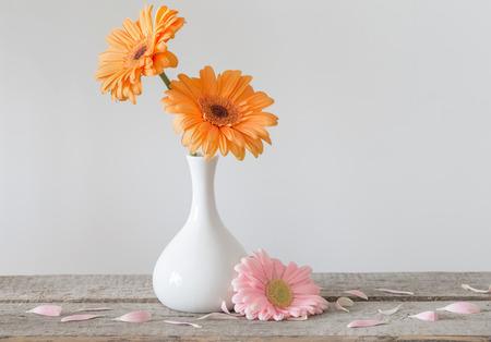Gerbera in vase on old wooden table