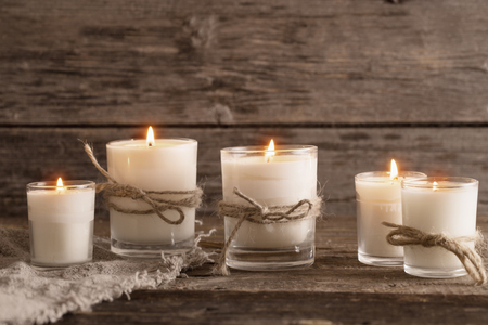 scented candles on old wooden background 免版税图像