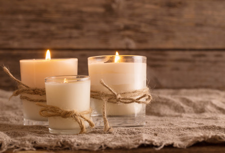 scented candles on old wooden background Standard-Bild