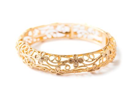 gold bracelet isolated on white