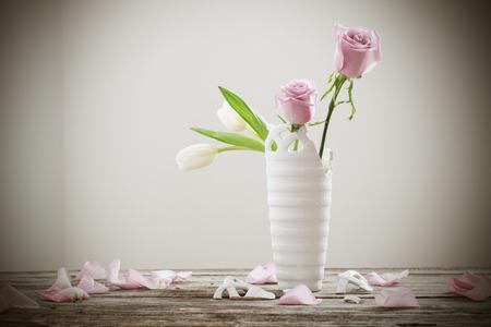 Pink Roses In Broken Flower Vase On Old Wooden Table Stock Photo
