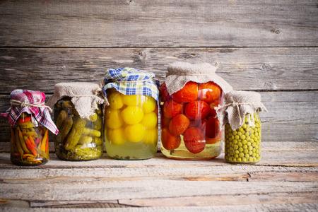 preserves: Vegetable preserves on wooden background
