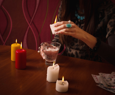 Divination with candle Stock Photo