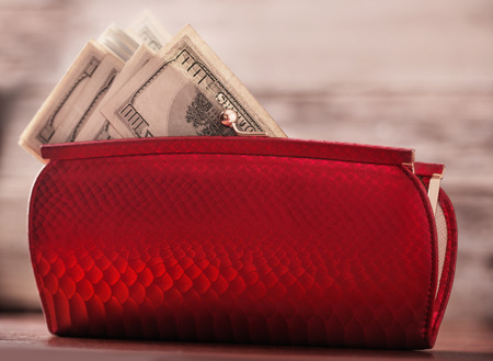Red purse and money Stock Photo