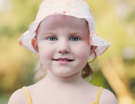 baby facial expressions: smile little girl outdoor Stock Photo
