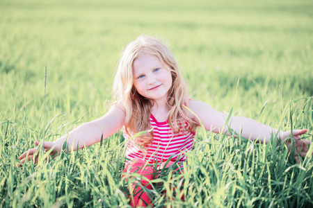 smile girl on the meadow Stock Photo