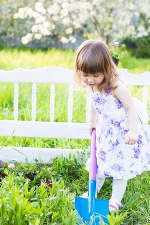 little gardening girl with shovel