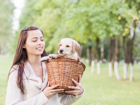 endear: Girl with her dog resting outdoors