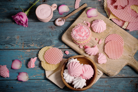 flower petal: pink dessert on old dark wooden table