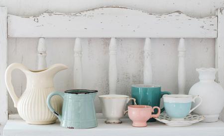 dinnerware on white wooden shelf