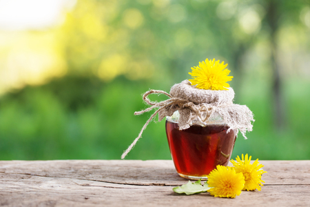 Jam from dandelions on a wooden table Stock Photo