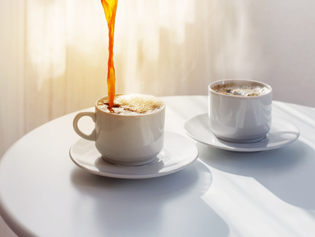 two cup of coffee on white table