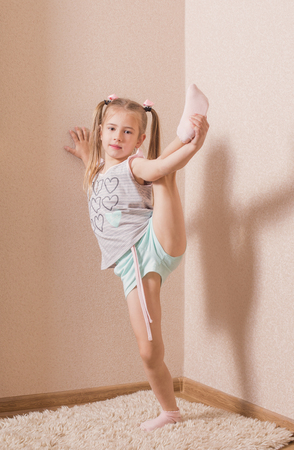 girl doing gymnastics at home