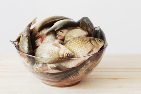 river raw fish on wooden table Reklamní fotografie