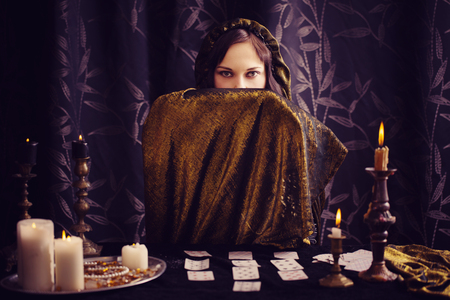 Young woman with divination cards in room