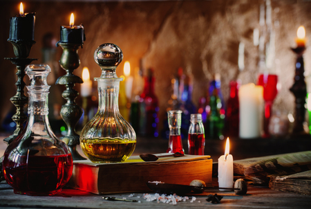Magic potion, ancient books and candles