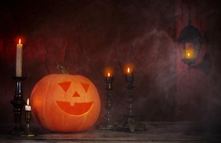 Halloween pumpkins on wooden table on dark background Stock Photo