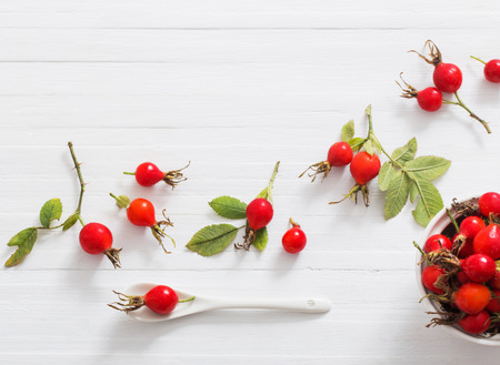 berries of a dogrose on a wooden background