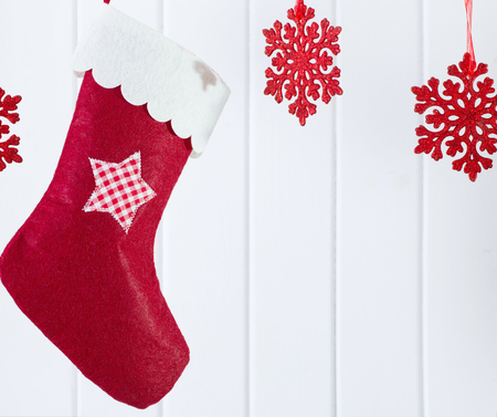 humor: Christmas stocking hanging against wooden background