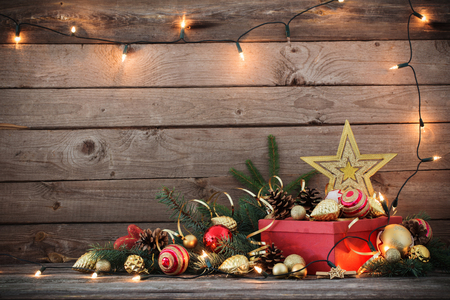 Christmas toys and red box on old wooden background Standard-Bild