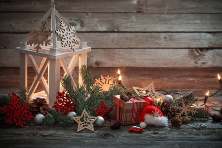 Christmas decoration with white lantern  on wooden background