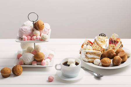 cup of coffee and dessert on white background