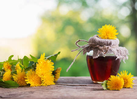Jam from dandelions on a wooden table Archivio Fotografico