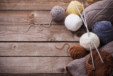 Knitting and knitting needles on a wooden surface Stock Photo - 94159412