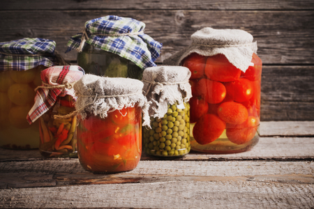 preserved vegetables in jar on old wooden background Stok Fotoğraf