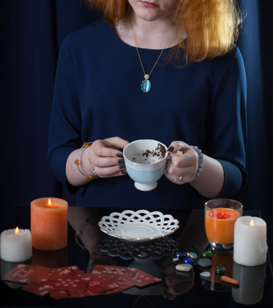 girl guessing on tea leaves