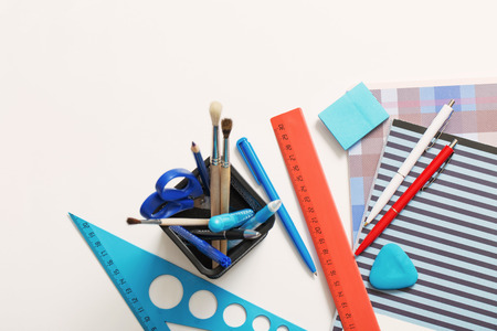 Collection of school supplies on white background
