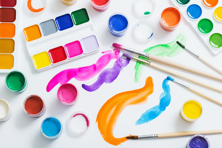 paints and brushes on paper Stock Photo