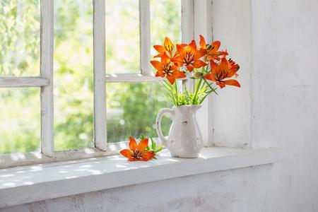 orange lily on windowsill Foto de archivo