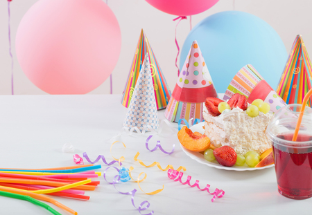 Birthday celebration with cake and colorful balloons