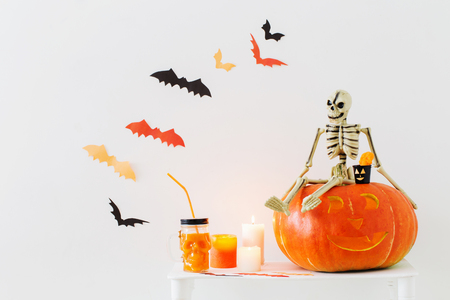 Halloween decorations on white wooden table Stock Photo