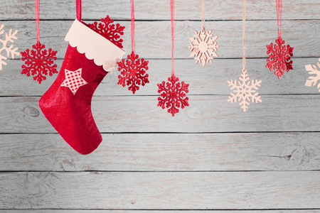 Christmas stocking hanging against wooden background