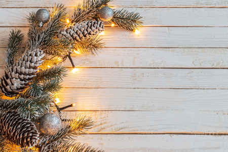 Christmas garland on white wooden background