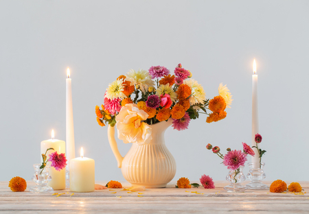 still life with  chrysanthemum and burning candles