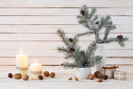 Christmas decorations on white old wooden background