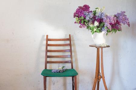 lilac in jug on old vintage interior