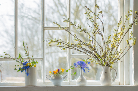 bouquet of flowers on the windowsill