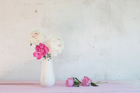 peonies in vase on white background