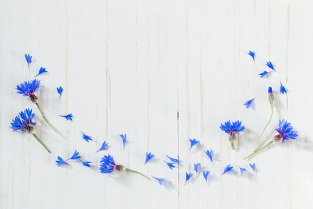 cornflowers on white wooden background Banco de Imagens