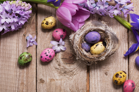 Easter eggs with spring flowers on wooden background Archivio Fotografico