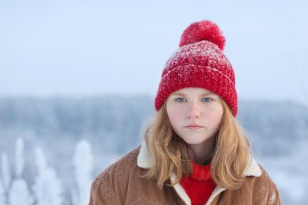 beautiful sad teen girl outdoor in wnter