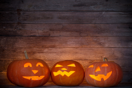 Halloween pumpkin on old wooden background