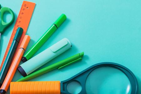 school supplies on blue background Standard-Bild - 124556239