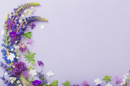 purple, blue, pink flowers on paper background Banco de Imagens