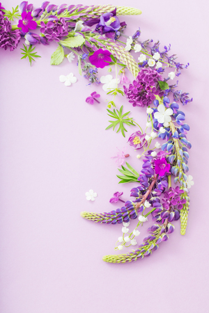 purple, blue, pink flowers on paper background Standard-Bild - 124556244