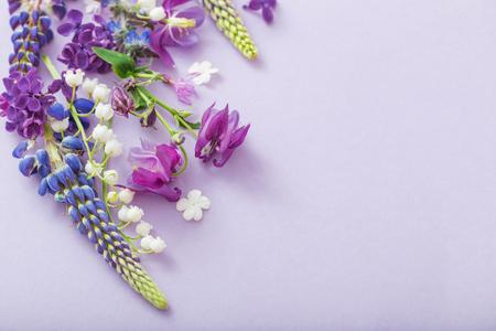 purple, blue, pink flowers on paper background Standard-Bild - 124556245